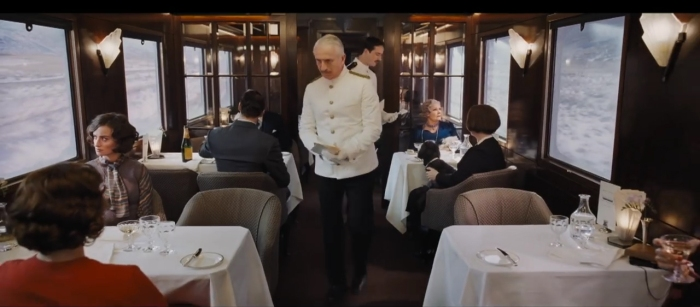 Murder On the Orient Express 2017 conductor in dining car